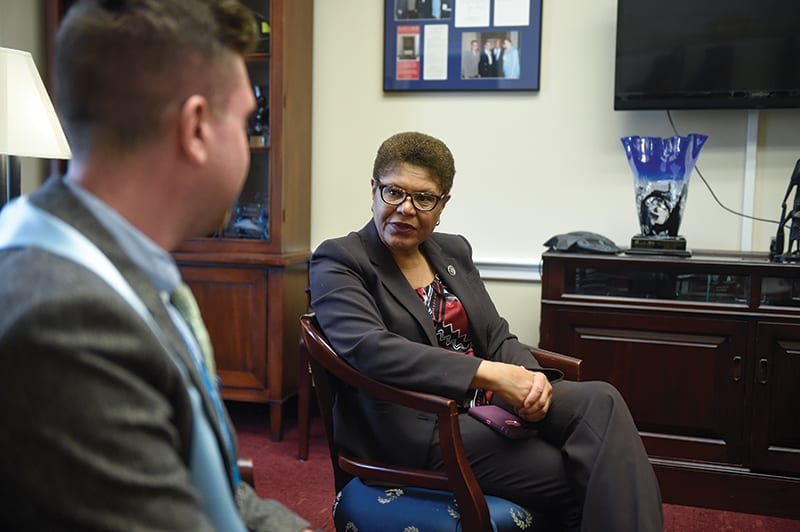 Rep. Karen Bass (D-Los Angeles) speaks to a former foster youth during National Foster Youth Institute's DC Shadow Day.